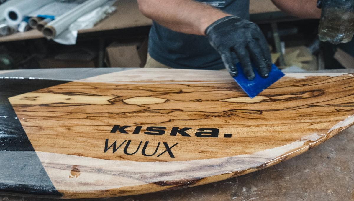 Clear coating KISKA x Wuux surf board in landscape crop