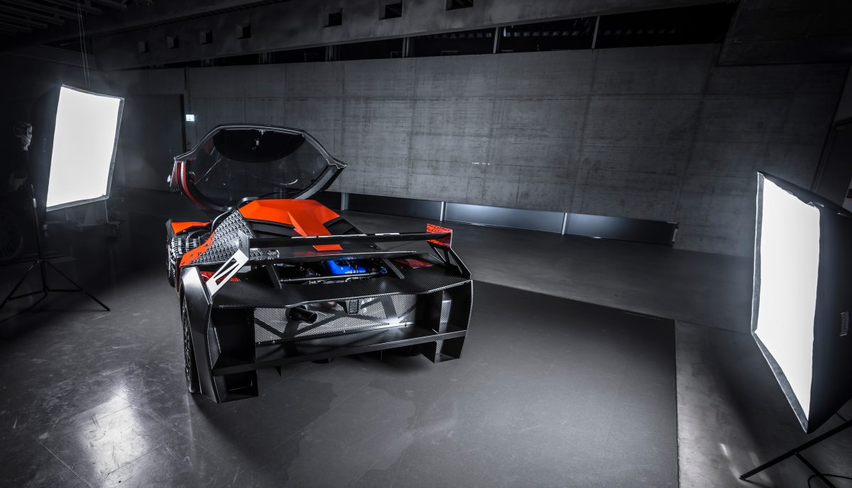 Rear view of KTM X-BOW GT4 with front hood open during a photo shoot