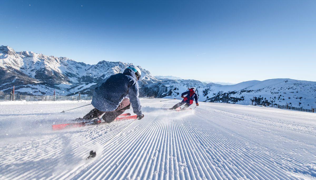 Downhill skiers using Atomic Redster ski equipment