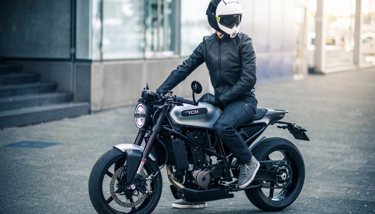 Side view of a rider on a Husqvarna Motorcycles VITPILEN 701 wearing functional street apparel