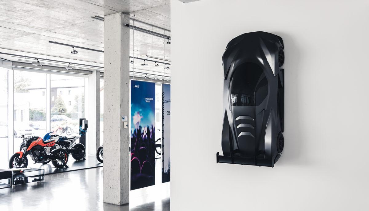 KTM X-Bow GTX hanging on wall inside KISKA Showroom
