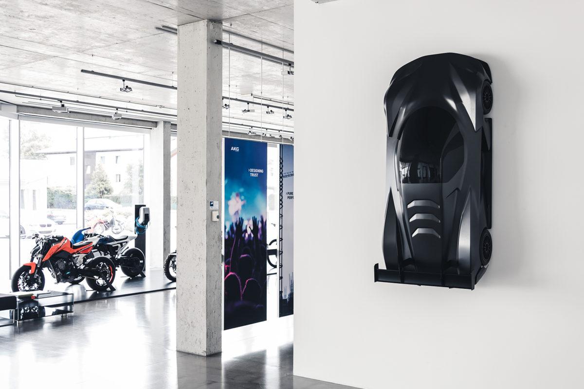 KTM X-Bow GTX hanging on wall inside KISKA Showroom - Mobile crop