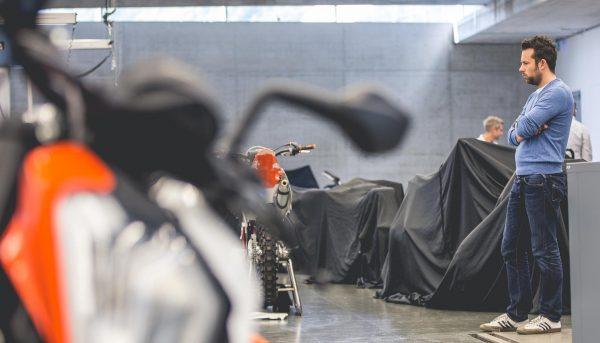 KISKA transportation designer reviewing a motorcycle design model