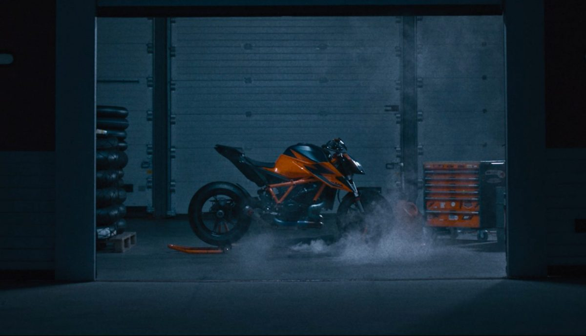 KTM 1290 Super Duke R in a race paddock from 2020 brand campaign